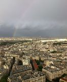 Rainbow and Storm Clouds over Paris. Storm clouds and a rainbow hang in a Paris Sky Royalty Free Stock Photography
