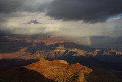 Rainbow, storm clouds and sun on Grand Canyon, Arizona. Rainbow, storm clouds and sun on Grand Canyon Royalty Free Stock Photos