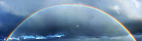 Rainbow and stormy clouds Royalty Free Stock Photos