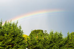 Rainbow on stormy sky Royalty Free Stock Images