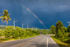 Rainbow in the stormy sky over the highway Royalty Free Stock Images