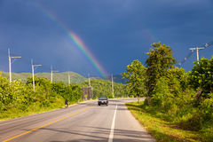 Rainbow in the stormy sky over the highway Royalty Free Stock Photography