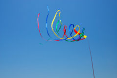 Rainbow Streamers. Streamers in bright colors spin in the wind on a sunny beach vacation Stock Photos