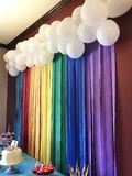 Rainbow Streamers. And white balloons stock image