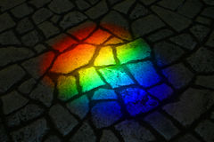 Rainbow on a street. Sunny ligth passed by prism with rainbow on a street vector illustration