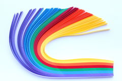 Rainbow strip of paper bend. Rainbow strip of paper on white background Stock Photo
