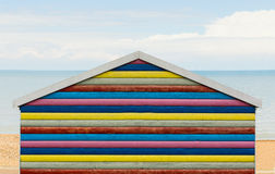 Rainbow striped beach hut Stock Photography