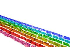 Rainbow stripes on bricks. Rainbow stripes on brick texture. Isolated on white Royalty Free Stock Image