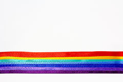 Rainbow of tapes. Rainbow of strips of silk texture, collected in a bright band of color of the rainbow Stock Photography