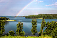 Rainbow in summer over lake in Belarus Royalty Free Stock Photos