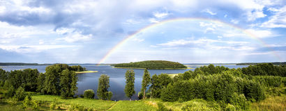 Rainbow in summer over lake in Belarus Royalty Free Stock Images