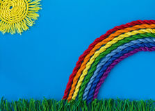 Rainbow, the sun and the grass of the thread Stock Images