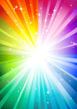 Rainbow sunburst. Background with glittering stars Stock Image