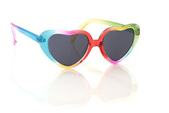 Rainbow Sunglasses. Heart shaped rainbow coloured sunglasses, isolated over white background with reflection Royalty Free Stock Image
