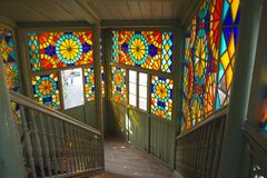 Rainbow sunny bunnies on the stairwell with stained glass windows
