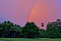 Rainbow at sunrise in Cambodia. Rainbow at sunrise near Angkor Wat in Cambodia Stock Photography