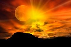 Sunset in an eclipse of sun in the mountains royalty free stock photos