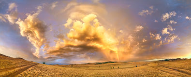 Rainbow at sunset after a storm on the way to Lake Baikal. Royalty Free Stock Photography