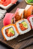 Rainbow sushi roll with salmon, tuna and eel Stock Images
