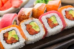 Rainbow sushi roll with salmon, tuna and eel Stock Photo