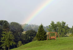 Rainbow swing for two Royalty Free Stock Images