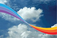 Rainbow swirl in blue sky Royalty Free Stock Photography