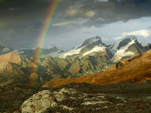 Rainbow in Swiss Alps, Switzerland. Stock Images