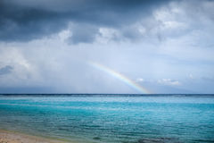 Rainbow on Temae Beach lagoon in Moorea island Royalty Free Stock Images
