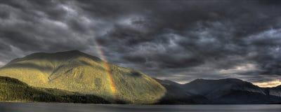 Rainbow, tempeste, buon e malvagità Immagine Stock