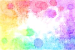 Rainbow Textured Watercolour Blots Background. Watercolours in the Rainbow Spectrum around the edge of the Background Stock Photo