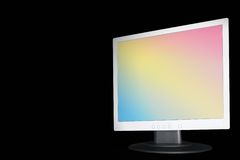 Rainbow TFT on Black. TFT flat monitor with rainbow screen on black background Royalty Free Stock Photos