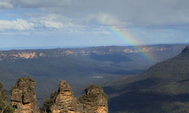 Rainbow in three sisters. A rainbow in three sisters lookout. This is a popular tourist attractions in blue mountain s , NEW, Australia . The place us around 1 1 Royalty Free Stock Photo