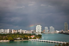 Rainbow and thunde rclouds over Star Island. Stormy clouds and rainbow over Star Island and South Miami Beach royalty free stock photo