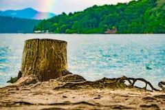 Rainbow after thunderstorm at lake jocassee south carolina stock photo