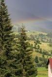 Rainbow after thunderstorm Stock Photo