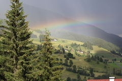 Rainbow after thunderstorm Royalty Free Stock Photo