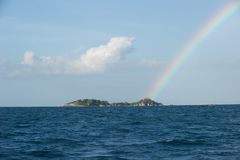 Rainbow on top of an island at belitung Stock Images