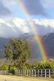 Rainbow and Topa Topa Mountains. Ojai, California Stock Photo