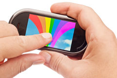 Rainbow on touch device Stock Images