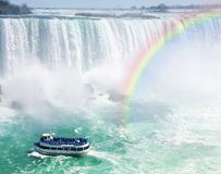 Rainbow and tourist boat at Niagara Falls Royalty Free Stock Image