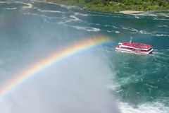 Rainbow at tourist boat on Niagara Falls. Stock Image