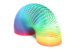 Rainbow Toy. Plastic rainbow colored spring toy isolation royalty free stock photo