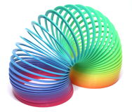 Rainbow Toy. Plastic rainbow colored spring toy isolation royalty free stock photography