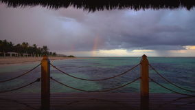 Rainbow after tropical rain on Punta Cana beach, Dominican Republic stock footage