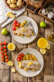 Rainbow trout fillet with roasted potatoes. Baked rainbow trout with roasted potatoes and homemade mayonnaise Stock Images