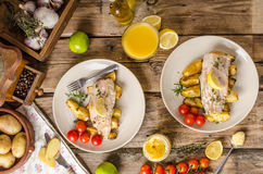 Rainbow trout fillet with roasted potatoes. Baked rainbow trout with roasted potatoes and homemade mayonnaise Royalty Free Stock Image