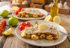 Rainbow trout fillet with roasted potatoes royalty free stock image