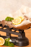 Rainbow Trout Fish. Rainbow trout with lemon and parsley herb on old fashioned weighing scales Stock Photography