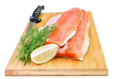 Rainbow trout fish fillet with knife on a kitchen board. Commercial composition of trout fish fillet stock photos