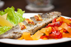 Rainbow trout fish. Tasty dish of rainbow trout fish with vegetables Royalty Free Stock Photos
